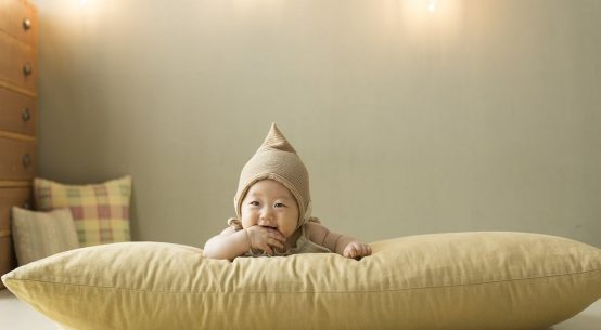 feather pillow and baby